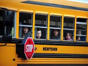 picture of kids riding a school bus